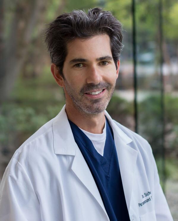 Dr. Adam Schuessler